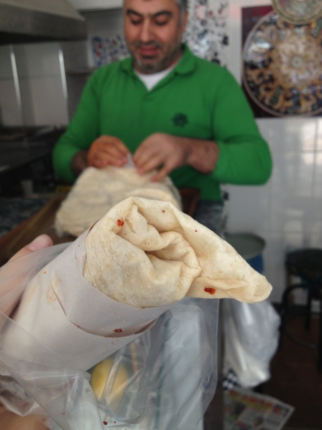Welcome to our day of epic eating. Best of the best? This spicy meat wrap, courtesy of this guy.